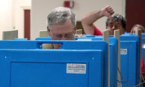 A voter gestures as Senate minority leader US Senator Mitch McConnell votes in Kentucky.