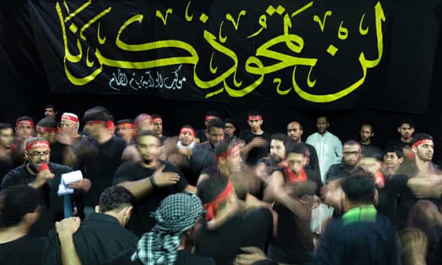Saudi Shia men mark Ashura, which commemorates the killing of Imam Hussein