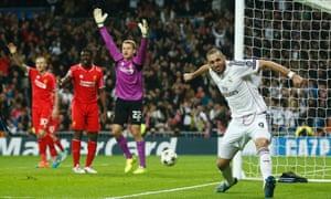 Real Madrid's Karim Benzema celebrates after scoring the opening goal.