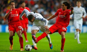 Javi Manquillo and Lazar Markovic attempt to stop a marauding Sergio Ramos