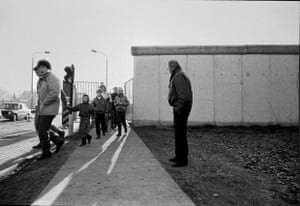 This photo was taken at Rudow, Berlin. The man waiting by the border was pacing up and down and chain-smoking. I asked him if he was waiting for someone and he replied: 'Yes, my daughter.' I asked how long since he had seen her. He stopped, turned to face me and said: 'Twenty-six years.' When I left, he was still waiting