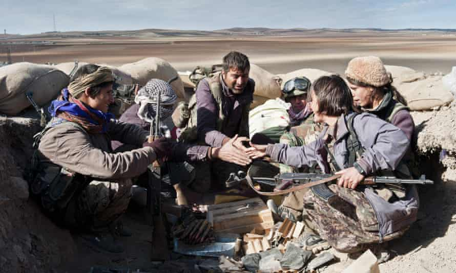 Kurdish fighters defend a position against encroaching Isis militants.