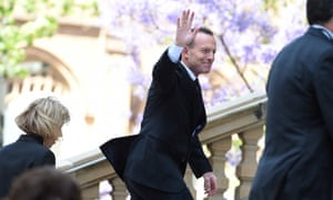 Tony Abbott arrives to jeers from the crowd outside Sydney town hall for the memorial service for Gough Whitlam.