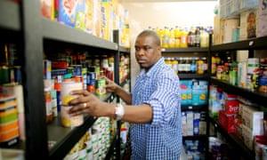 A volunteer packs the shelves at Croydon food bank.