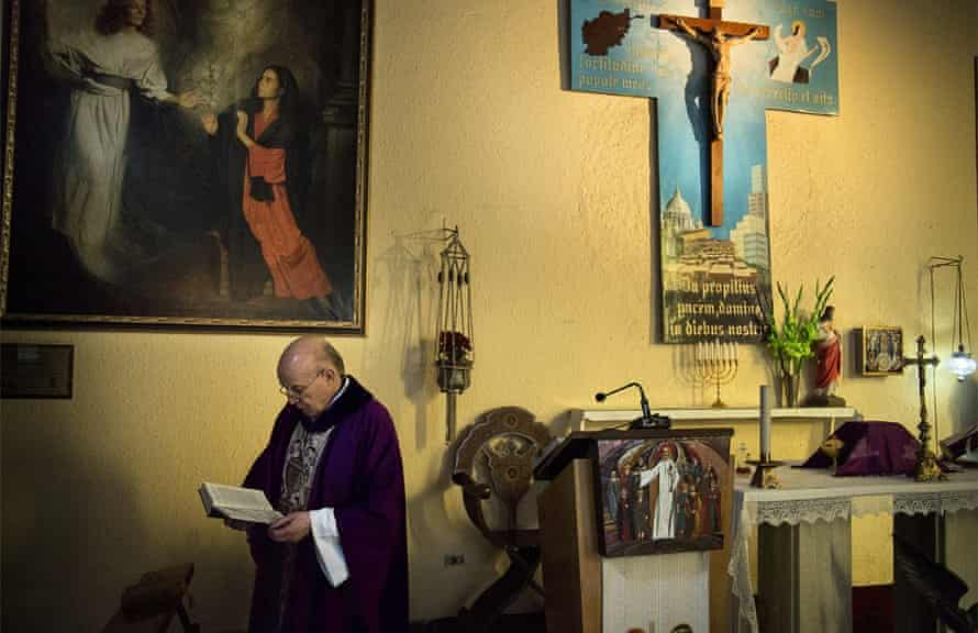 Father Giuseppe Moretti in his church at the Italian embassy