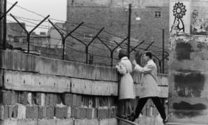 West Berlin, 1961. A young woman talks to her mother on the eastern side of the newly erected Wall.