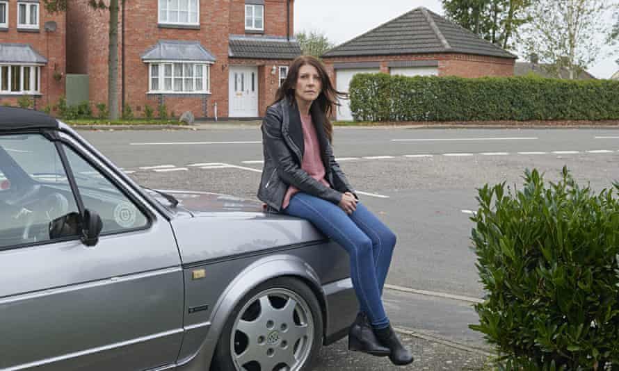 Mel Hurd in her front garden with her VW Golf