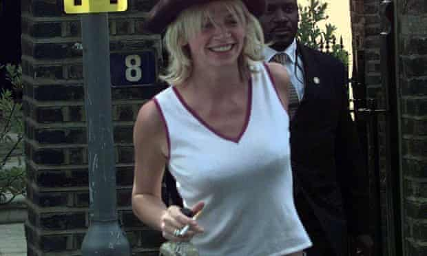 Zoe Ball on her way to her wedding holding a bottle of Jack Daniel's