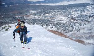 men on skis on a snowy mountain