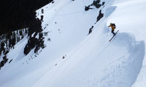 Ralph Tadday slides off a cornice in the Three Sisters Wilderness in Oregon.