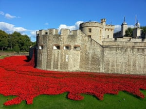 Tower of London WW1 poppies.  The poppies were glowing in the late afternoon sun, and the contrast of the white stone and blue sky made them all the more striking.