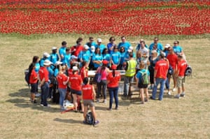 The poppy team. When I visited the Tower at the end of July, I saw the the poppy team. The team installing the poppies are gathered round for a meeting. In the background you can see some of the thousands of poppies already set out, and consider how many more would be needed to mark each British fatality during the first world war. Awful, both in the classical and modern sense of the word.