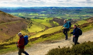 Walkers on Offa's Dyke path with a view of the market town of Ruthin