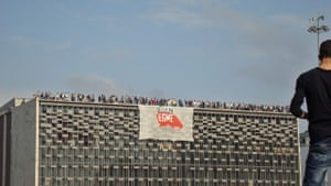 Gezi Park Protests Istanbul - To the roof! Protesters occupy the roof of the Ataturk Cultural Centre in Taksim Square during last year's Gezi Park protests in Istanbul