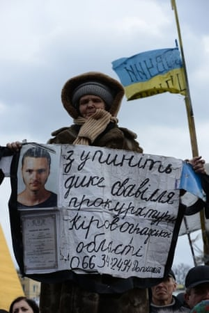 Ukranian woman displays information about missing son A sad mother displays information during protests in Maidan Square, hoping to find information about her missing son, March 2014 .
