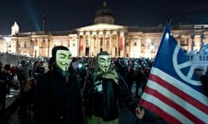 Million Mask March protesters in Trafalgar Square, London