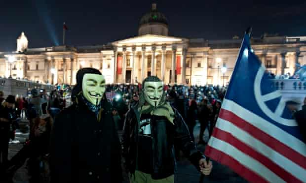 Million Mask March protesters in Trafalgar Square, London