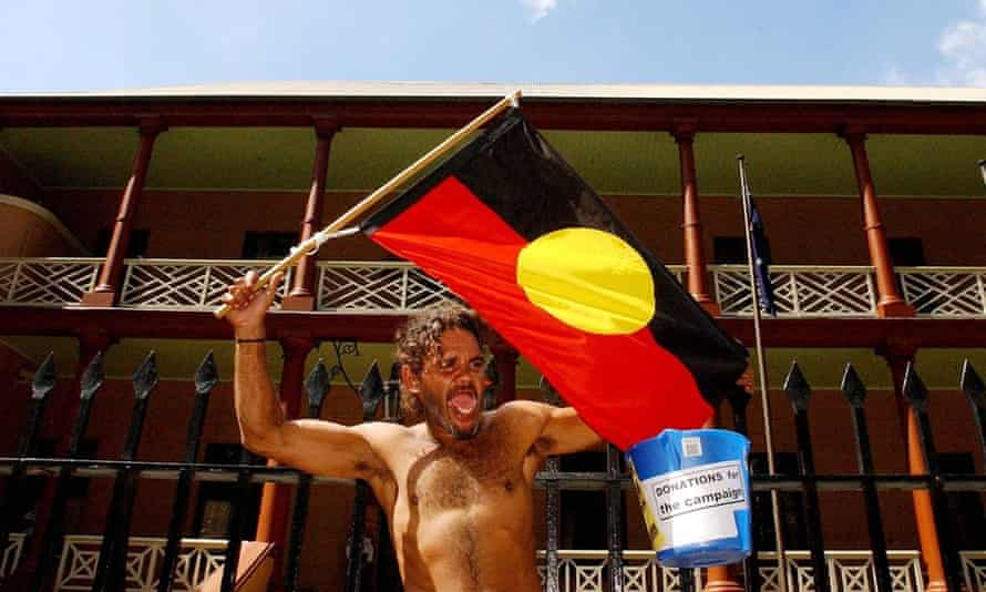 An Aboriginal protester outside the gates of New South Wales Parliament House.