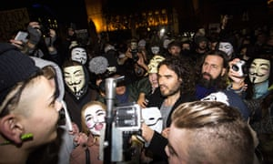 Russell Brand joins anti-capitalist protesters during the Million Masks March in London