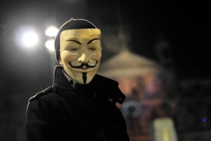 masked person by glasgow city chambers for million mask march