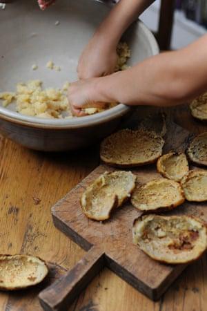 mashing the potato filling