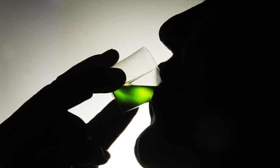 An addict takes his prescription of methadone