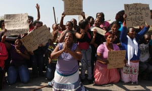 Women protest and sing for justice for the 34 killed platinum miners at Marikana.