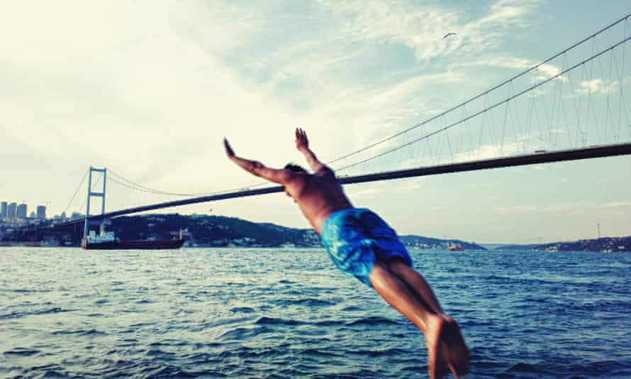 A swimmer launches himself into the Bosphorous