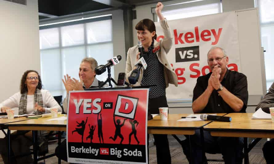 Campaign manager Sara Soka, center, celebrates with fellow supporters after the passing of Measure D, imposing a sales tax on soda drinks, in Berkeley