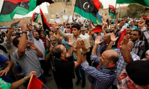 Libyans celebrate after the supreme court invalidated the country's parliament.
