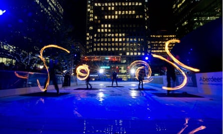 Fire torch display in Canada Square, Canary Wharf