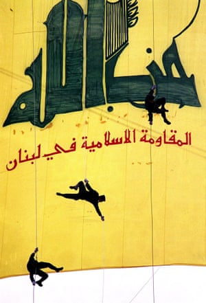 """Black-clad Hezbullah militants descend in front of a giant banner reading """"Hezbullah, the Islamic Resistance in Lebanon,"""" 5 January in a southern suburb of Beirut to mark """"International Qods (Jerusalem) Day,"""" which was first established by Iran after the 1979 Revolution."""