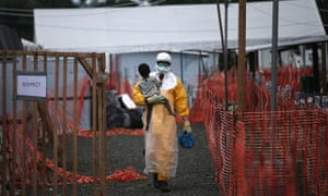MSF doctor holding child suspected of having Ebola in Liberia