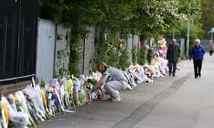 Floral tributes to Ann Maguire outisde the school