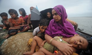 Rohingya muslims trying to cross the Naf river into Bangladesh to escape sectarian violence in Myanm