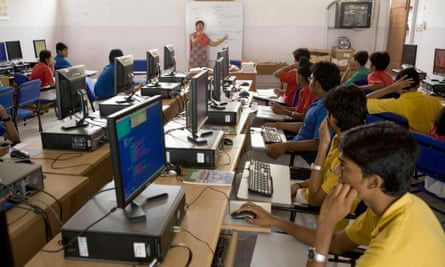 Students in a computer studies class at school in Hazira, India
