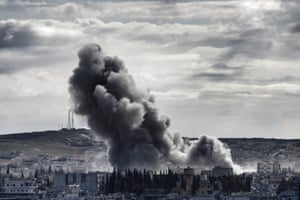 Smoke rises above Kobani. Iraqi peshmerga fighters were preparing to join the fight against the jihadis for the town, lifting residents' hopes of a turning point in the battle