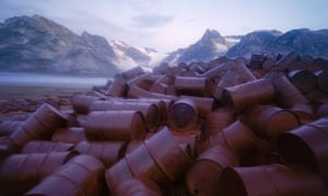 oil barrels in front of mountains