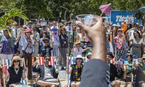 Protesters raise a glass at the mock tax haven in Brisbane.