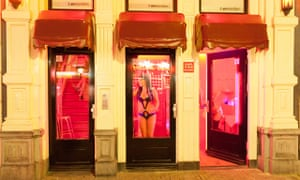 Prostitutes in windows in red light district in Amsterdam