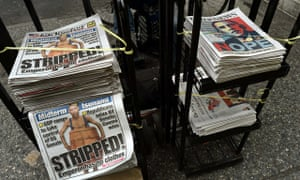 A newspaper stand on 42nd Street with he