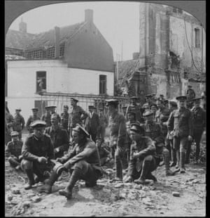Watching the effect of German bombardment of a French town.