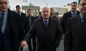 Former Soviet leader Mikhail Gorbachev walks across Pariser Platz near the Brandenburg Gate on the e