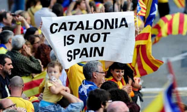Catalans gather in a bid to create a 400-kilometre (250-mile) human chain, part of a campaign for independence from Spain.