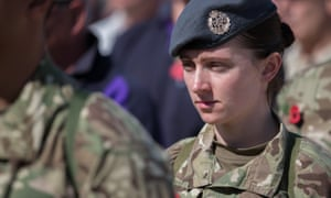 British troops and service personal remaining in Afghanistan are joined by International Security Assistance Force (ISAF) personnel and civilians as they gather for a Remembrance Sunday service at Kandahar Airfield.