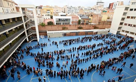 Catalans queue at a polling station for the independence vote in Barcelona