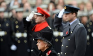 Queen Elizabeth II observes a moment of silence at the Cenotaph. In background is Prince William, The Duke of Cambridge.