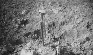 Battle of Morval. A makeshift grave in a shell-hole, marked by an inverted rifle driven into the ground near Combles.