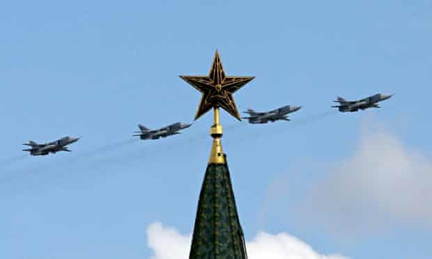 Russian military jets fly in formation above the Kremlin