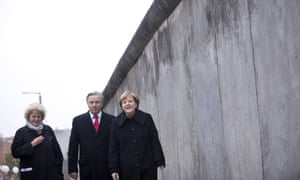German chancellor Angela Merkel walks along a section of the former Berlin Wall during celebrations for the 25th anniversary of its fall.